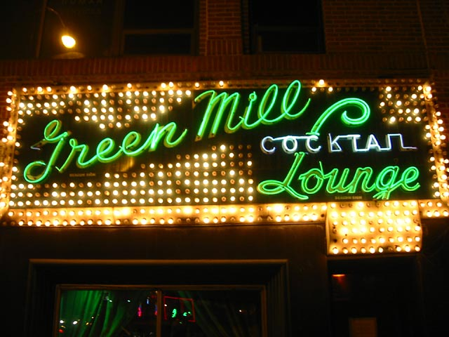 exterior night shot of Chicago's famous Green Mill speakeasy and jazz bar, with the lights aglow