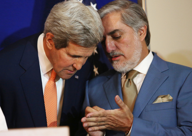 Afghan presidential candidate Abdullah Abdullah, right, speaks to U.S. Secretary of State John Kerry