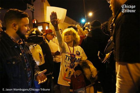 Lady giving a sieg heil at a Trump rally | Tacky Harper's Cryptic Clues