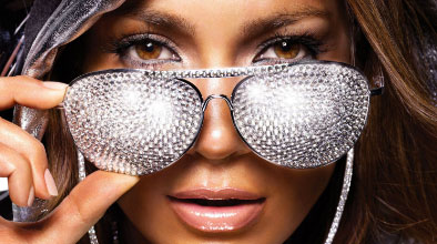 glamour | lady with rhinestone encrusted sunglasses | Tacky Harper's Cryptic Clues